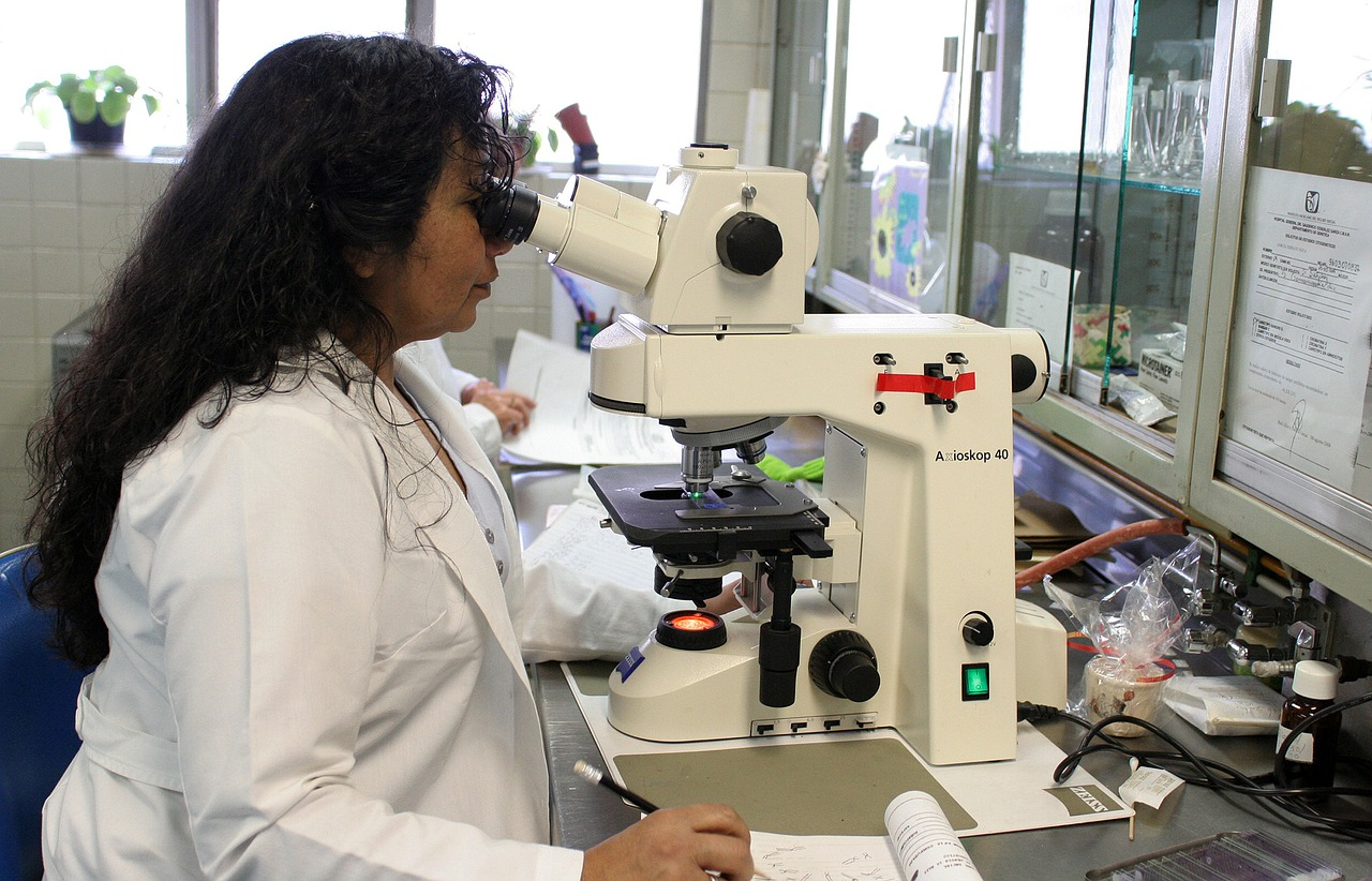 Doctor looking at the DNA in a microscope