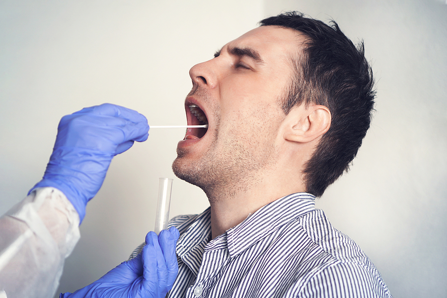 Man getting a swab test for DNA paternity test
